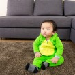 Stock Photo: AsiBaby with dinosaur halloween party costume