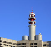 Broadcast tower on building — Stock Photo