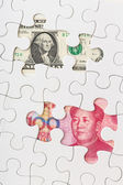 US and Chinese currency as part of puzzle — Stock Photo