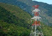 Power distribution tower on mountain — Stock Photo