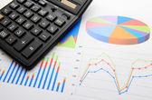 Data chart with calculator — Stock Photo