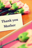 Carnation flower and thank you card — Stock Photo