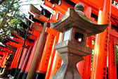Stone lantern with torii — Stock Photo