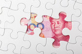 Incomplete puzzle over chinese yuan banknote background — Stock Photo
