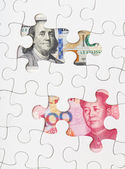 US dollar and chinese yuan with white puzzle — Stock Photo