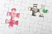 US and chinese yuan with white puzzle for exchange rate concept — Stock Photo