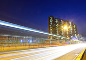 Fast moving traffic in city — Stock Photo