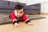 Little boy creeping on floor — Stock Photo