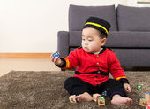 Little boy play with toy block — Stock Photo