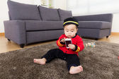 Little boy play with mobile phone — Stock Photo