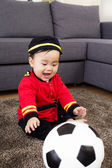 Little baby playing with football — ストック写真