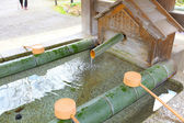 Water purification in japanese temple — Stock Photo