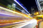 Fast moving car light in city — Stock Photo