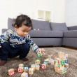 Stock Photo: Asibaby boy concentrate on playing toy block