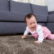 Stock Photo: Baby crawl on floor at home