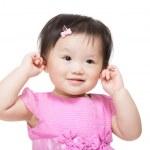 Adorable little girl plugs her ears — Stock Photo #41594731