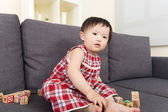 Asian baby girl play with toy block — Stock Photo