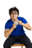 Asia man play tv game — Stock Photo