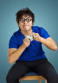 Asian man play tv game — Stock Photo