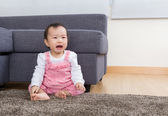 Baby girl crying at home — Stock Photo