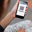 Woman hand holding mobile phone with QR code coupon — Stock Photo #41895185