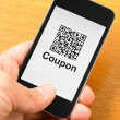 Stock Photo: QR code coupon on mobile