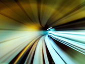 Train moving fast in tunnel — Stock Photo