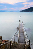 Wooden bridge to seascape — Stock Photo