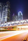 Hong Kong city with traffic trail — Stock Photo