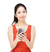 Asian woman holding mobile phone — Stock Photo