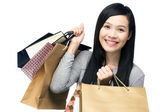 Asian woman with lots of shopping bag — Стоковое фото
