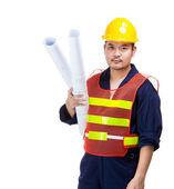 Asijské stavební dělník s modrým potiskem — Stock fotografie