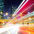 Fast moving car light in city at night — Stock Photo #42402177