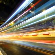 Fast moving car light on road at night — Stock Photo #42405651