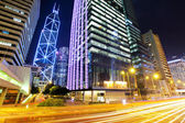 Central business district in Hong Kong with traffic trail — Stock Photo