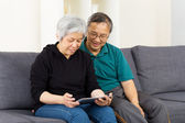 Asian couple using tablet together — Stock Photo