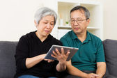 Asian old couple using tablet — Foto de Stock