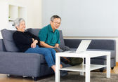 Asia old couple watching on computer at home — Stock Photo