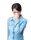 Asian woman sneeze isolated — Stockfoto