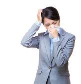 Asian businesswoman sneeze and headache — Stockfoto