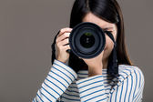 Asia female photographer — Stock Photo