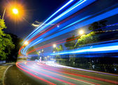 Busy traffic on road at night — Stock Photo