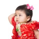 Chinese baby girl touching her head — Stock Photo #42885621