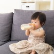 Asian baby girl feed with milk bottle — Stock Photo #42885709