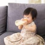 Asian baby girl having milk — Stock Photo #42885723
