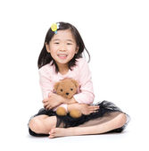 Girl and doll — Stock Photo
