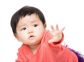 Asian baby girl pointing front — Stock Photo