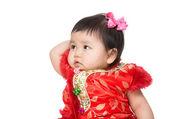 Chinese baby girl touching her head — Stock Photo