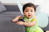 Asian baby girl with halloween party dressing at home — ストック写真