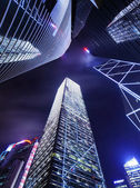 Skyscraper in Hong Kong from low angle at night — Stock Photo